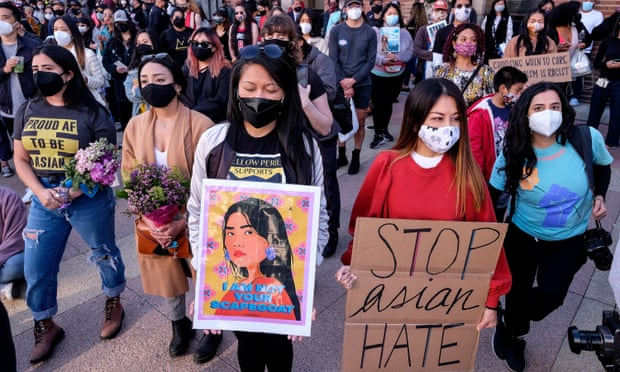 Demonstrators take part in a rally to raise awareness of anti-Asian violence in Los Angeles on 13 March. Photograph: Ringo Chiu/AFP/Getty Images
