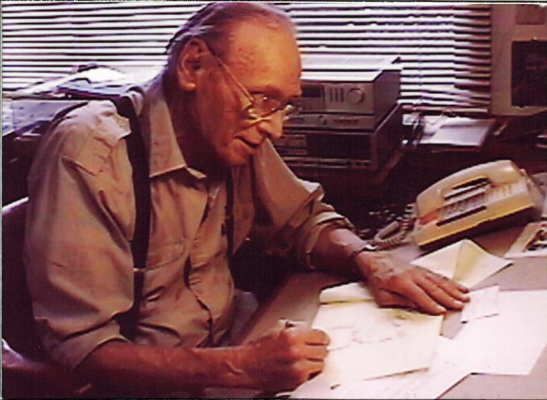 Cartoonist Ben Brown at his drawing desk, c. 1990s